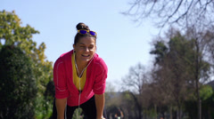 Happy woman resting in park, slow motion shot at 240fps, steadycam shot Stock Footage