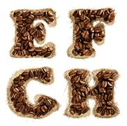Alphabet from coffee beans on fabric texture isolated on white Stock Photos