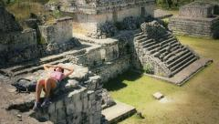Trekker resting over pyramides Stock Footage