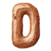 Letters made of caramel cookies Stock Photos
