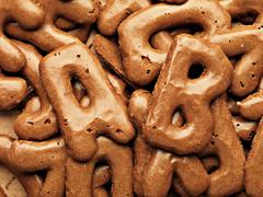 Cookie alphabet background Stock Photos