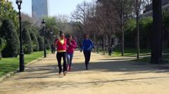 Woman winning race in park, slow motion shot at 120fps, steadycam shot Stock Footage