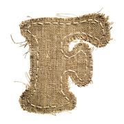 Letter clipped from linen fabric Stock Photos