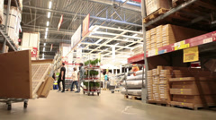 Moving through the Ikea warehouse with shopping customers - stock footage