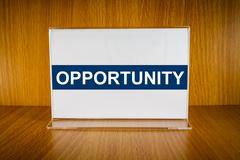 opportunity on acrylic card holder - stock photo