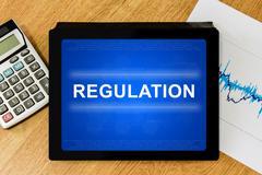 Stock Illustration of regulation word on digital tablet