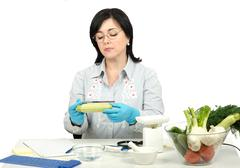 Phytosanitary inspector measuring the lenght of zucchini Stock Photos
