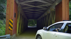 4K Car Passes over Covered Bridge in McConnells Mill State Park 4361 Stock Footage
