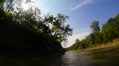 Kayaking on Denton Creek past sunken tree stumps Stock Footage