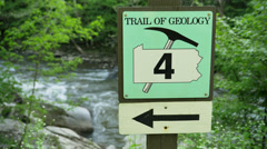 Stock Video Footage of Geology Directional Sign on a Pennsylvania Trail
