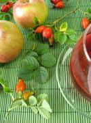 Fruit tea with rose hips and apples Stock Photos
