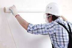attaching wallpaper - stock photo