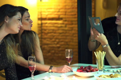 Women chatting and taking photos by smartphone, slow motion shot at 120fps Stock Footage