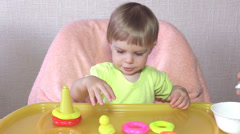 The baby eats children's porridge Stock Footage