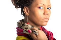 young woman with python - stock photo