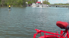 Paddle Boarder and Red Bicycle Stock Footage