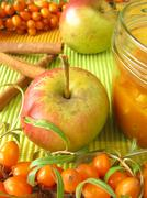 Jam from fruits of sea buckthorn, apples and cinnamon Stock Photos