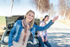 Car defect two women wait for help - stock photo