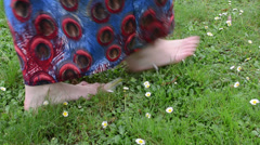 Bare foot woman with dress walk meadow full of daisy flowers Stock Footage