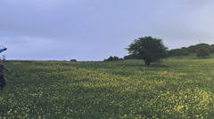 Young Woman Running Through Flower Field Umbrella Overcast Stock Footage