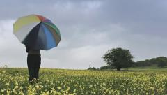Woman Spinning Umbrella Flower Field Autumn Rain Concept Stock Footage