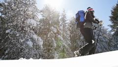 Backpacker Walking in the Mountains Snow Terrain Snowshoes - stock footage