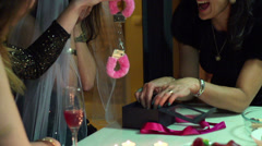 Young woman opening gift at bachelorette party, slow motion shot at 60fps Stock Footage