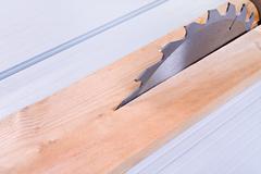 Circular saw cutting wooden plank Stock Photos
