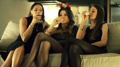 Young women on sofa having fun at bachelorette party, slow motion shot at 240fps Stock Footage