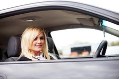 Attractive blonde behind the wheel - stock photo