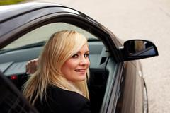 Attractive blonde female driver Stock Photos