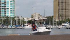 Coast Guard men tying up their boat Stock Footage