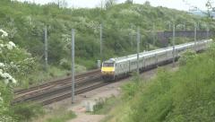 Diesel train travailing through a cutting. Stock Footage
