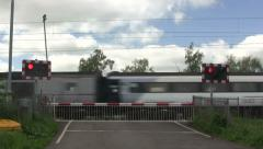 Stock Video Footage of Diesel train crossing a level crossing.