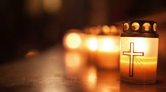 Night of Churches, close-up shot of burning candle with cross symbol - stock footage