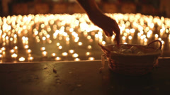 Night of Churches, woman taking candle - stock footage