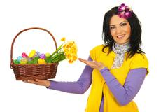 Spring woman showing Easter basket Stock Photos