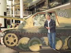 Man Posing Infront A Military/Army Tank - stock photo