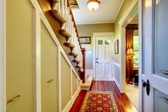 home classsic decor hallway with entrance front door. - stock photo