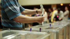 Men's hands put the electoral billeting in the ballot box Stock Footage
