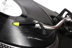 Turntable playing vinyl record Stock Photos