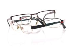 Pile of three eyeglasses Stock Photos
