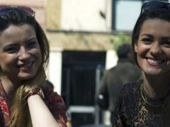 Women smiling to the camera, steadycam shot Stock Footage