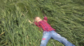 Child, Little Girl Relaxing, Laying in Wheat, Rye Field, Kid Sleeping in Nature HD Footage