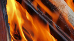 Fire, Natural Wood Planks and Logs Burning 5 Stock Footage