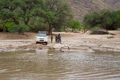 Crossing of a river by 4x4 - stock photo