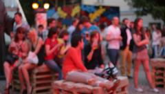 People at the evening outdoor party. Out of focus Stock Footage