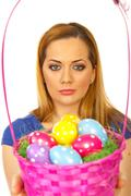 Beauty blond woman with Easter basket Stock Photos