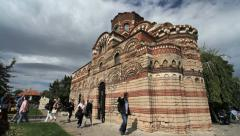 Bulgaria Nessebar Orthodox Church tourists with guide Stock Footage