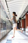 Running of a woman in rush hours on train station - stock photo